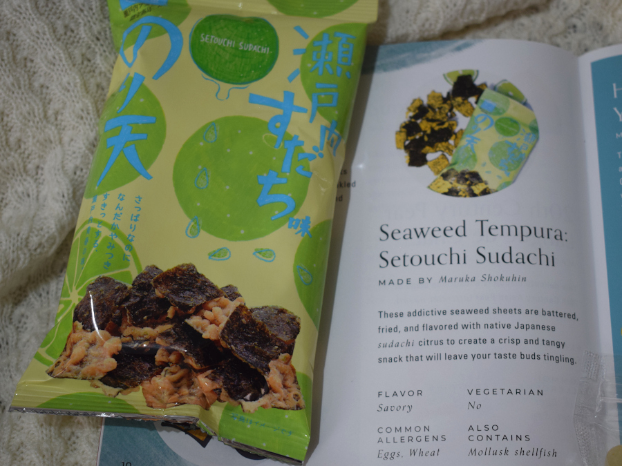 One packed of battered fried seaweed chips next to a leaflet describing it